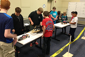 Radford University student mentors and faculty helped Radford City middle and high school students build robots that battled in a sumo-style competition.
